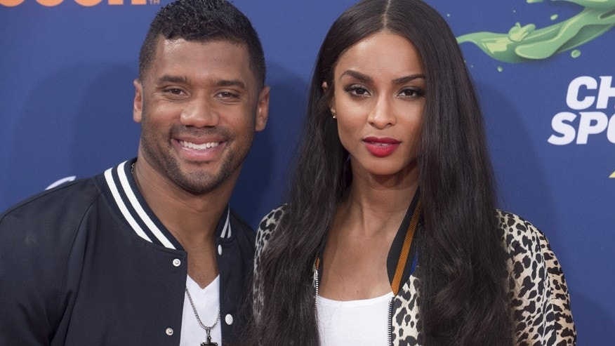 "NFL player Russell Wilson (L) and recording artist Ciara attend Nickelodeon's ""Kid's Choice Sports 2015"" in Los Angeles July 16, 2015."