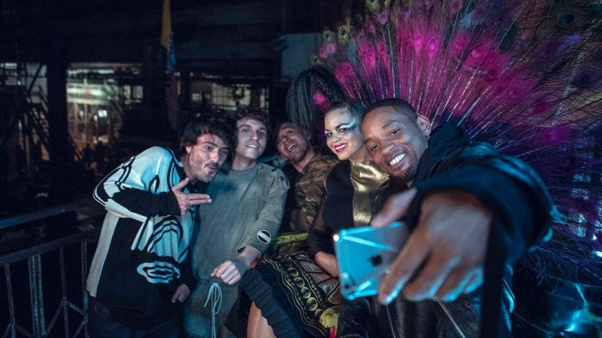 Members of Bomba Estereo pose for a selfie with actor-singer Will Smith.