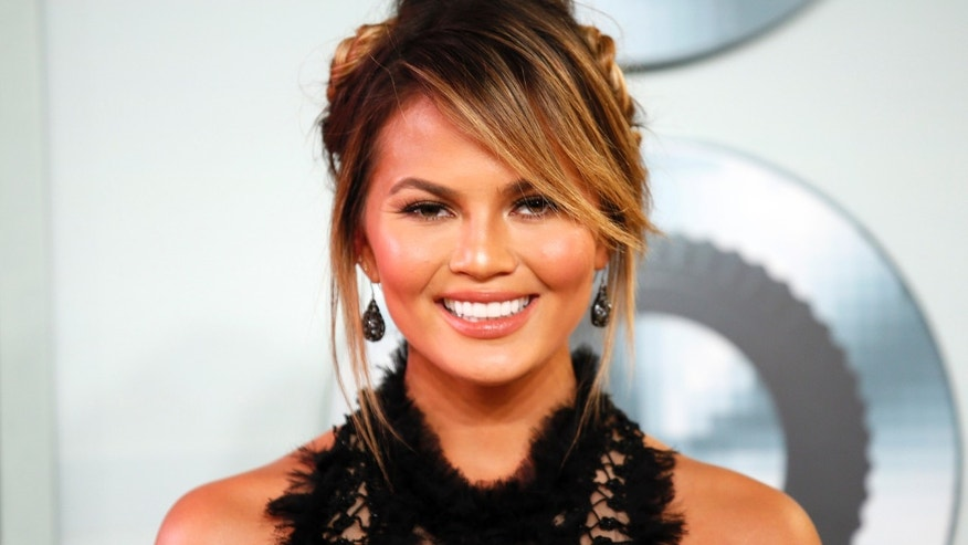 August 30, 2015. Model Chrissy Teigen arrives at the 2015 MTV Video Music Awards in Los Angeles, California.