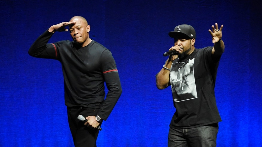 "April 23, 2015. N.W.A. members Dr. Dre, left, and Ice Cube, two of the subjects of the upcoming biographical drama ""Straight Outta Compton,"" salute the crowd after speaking at the Universal Pictures presentation during CinemaCon 2015 at Caesars Palace, in Las Vegas."