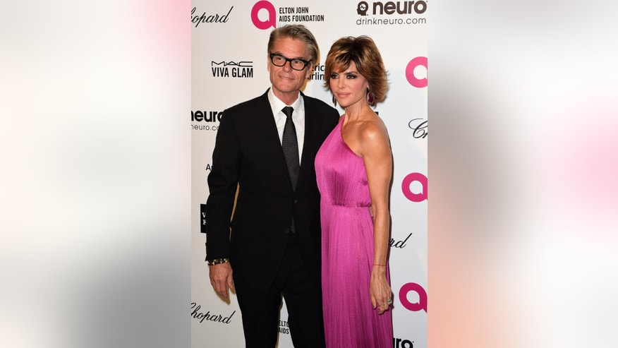 Actress Lisa Rinna and her husband, actor Harry Hamlin, arrive at the 2015 Elton John AIDS Foundation Oscar Party in West Hollywood, California February 22, 2015. REUTERS/Gus Ruelas (UNITED STATES TAGS: ENTERTAINMENT) (OSCARS-PARTIES) - RTR4QO8Y