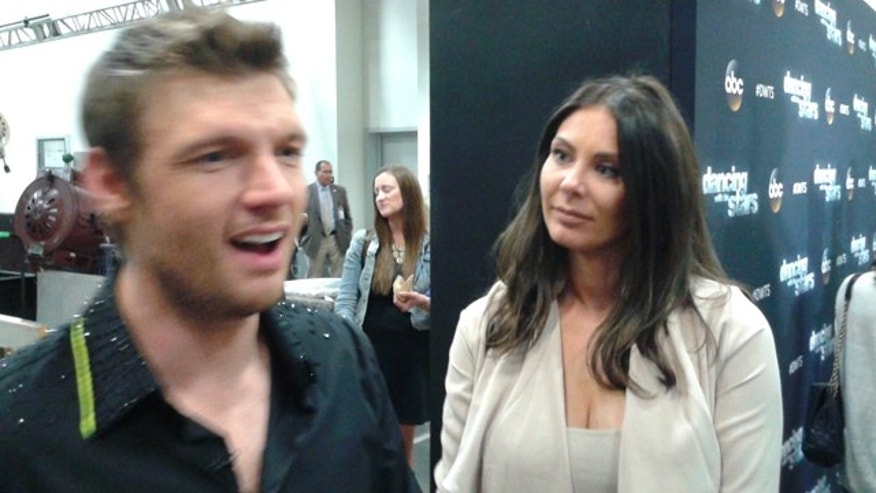 Nov. 2, 2015: Nick Carter talks with reporters as wife Lauren looks on following an episode of 'Dancing With The Stars' (Carole Glines)