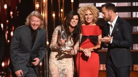 "Phillip Sweet, from left, Karen Fairchild, Kimberly Schlapman and Jimi Westbrook, of Little Big Town, accept the award for single of the year for ""Girl Crush"" at the 49th annual CMA Awards at the Bridgestone Arena on Wednesday, Nov. 4, 2015, in Nashville, Tenn. (Photo by Chris Pizzello/Invision/AP)"
