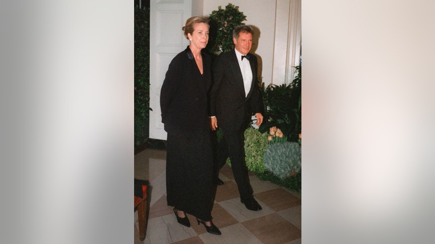 FILE - In this Feb. 5, 1998 file photo, Harrison Ford and his wife Melissa Mathison arrive at the White House for an official dinner for the British Prime Minister hosted by President Clinton in Washington.