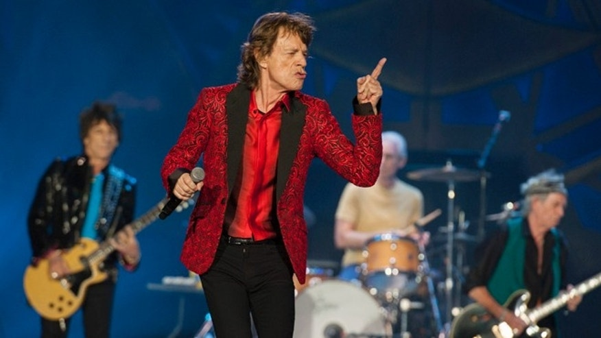 FILE - In this July 4, 2015 file photo, Ronnie Wood, Mick Jagger, Charlie Watts and Keith Richards of the Rolling Stones perform at the Indianapolis Motor Speedway  in Indianapolis. On Thursday, Nov. 5, 2015,  the band announced âThe America Latina Oléâ tour, which will kick off Feb. 3 in Santiago, Chile. (Photo by Barry Brecheisen/Invision/AP)