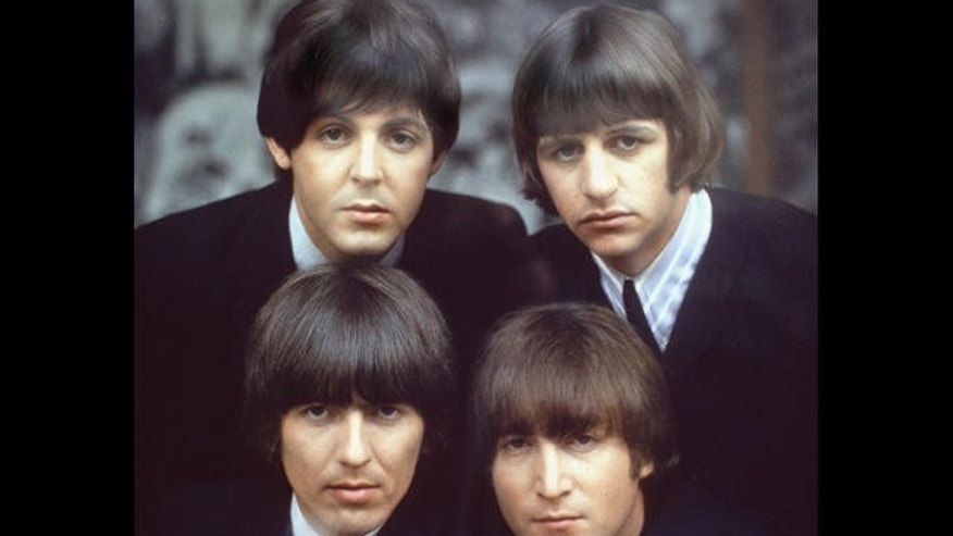 The Beatles are shown on an album cover in 1965.  Clockwise, from top left, are: Paul McCartney, Ringo Starr, John Lennon, and George Harrison.