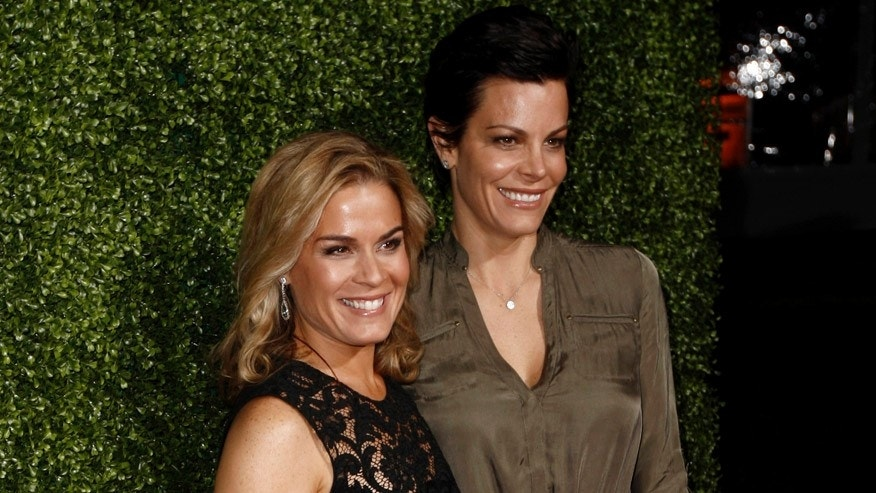 FILE - In this Jan. 6, 2011 file photo, Cat Cora, left, and Jennifer Cora arrive at the Oprah Winfrey Network Television Critics Association 2011 Winter Press Tour Cocktail Reception in Pasadena, Calif. Cat Cora announced Monday, Nov. 9, 2015, that she and her partner of 17 years, Jennifer Cora, are divorcing and plan to jointly raise their four sons. Court records in Santa Barbara, California, show the pairfiled for divorce in late October 2015. (AP Photo/Matt Sayles, File)