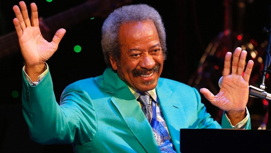In this Tuesday April 30, 2013, photo, Allen Toussaint thanks the audience after a benefit concert/tribute in his honor at Harrah's New Orleans Theatre, in New Orleans. Legendary New Orleans musician and composer Toussaint died Monday, Nov. 9, 2015, after suffering a heart attack following a concert he performed in Madrid. He was 77. (David Grunfeld/NOLA.com The Times-Picayune via AP)