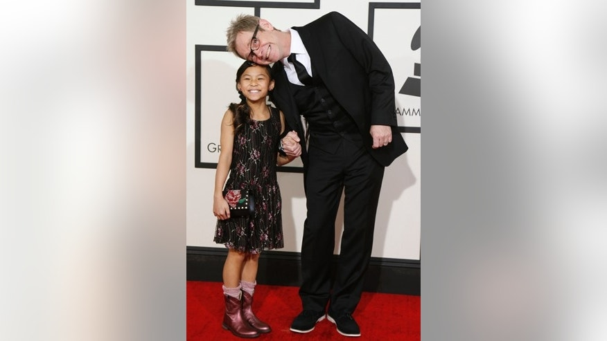 Contemporary Christian artist Steven Curtis Chapman and his daughter arrive at the 56th annual Grammy Awards in Los Angeles, California January 26, 2014.