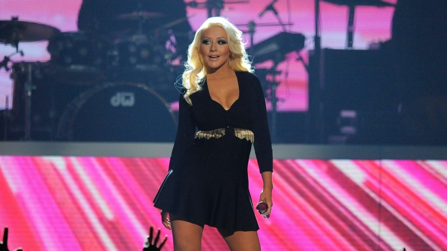 FILE - This May 19, 2013 file photo shows Christina Aguilera performing at the Billboard Music Awards in Las Vegas. Aguilera is planning to have an entire brass horn section to back her up, and a special set list for Friday nights show during Jazz Fest, including  Lady Marmalade, the Patti LaBelle song she helped remake into a hit years ago. (Photo by Chris Pizzello/Invision/AP, File)