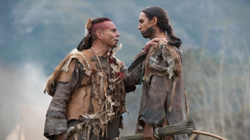 Raoul Trujillo as Massasoit, left, and Tatanka Means as Hobbamock in National Geographic Channelâs two-night movie event âSaints & Strangers,â premiering Nov. 22-23, 9/8c.â¨â¨(photo credit:  National Geographic Channels/David Bloomer)