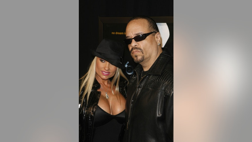 "January 7, 2009. Rapper Ice T and his wife Nicole ""CoCo"" Austin arrive for the premiere of the film ""Notorious"" in New York."