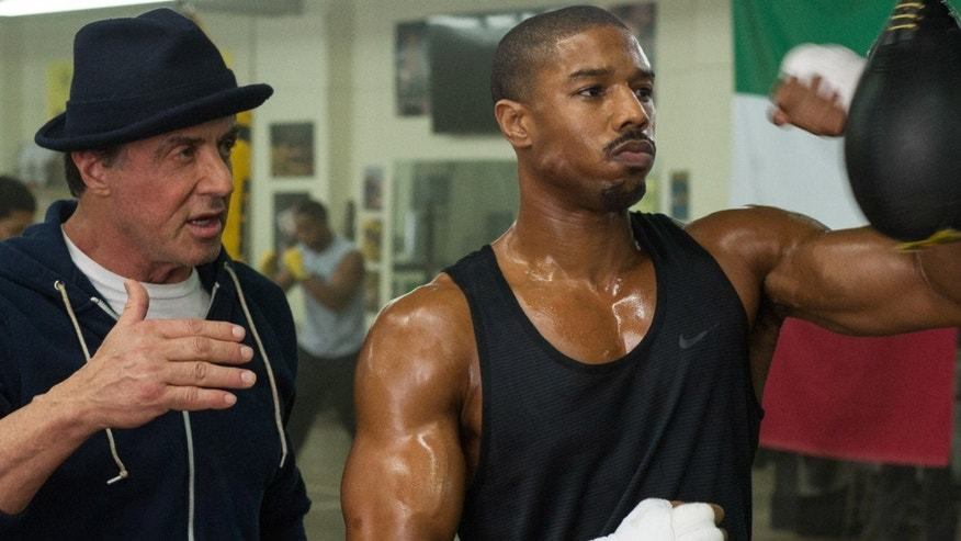 """Michael B. Jordan, right, as Adonis Johnson and Sylvester Stallone as Rocky Balboa in """"Creed."""""""