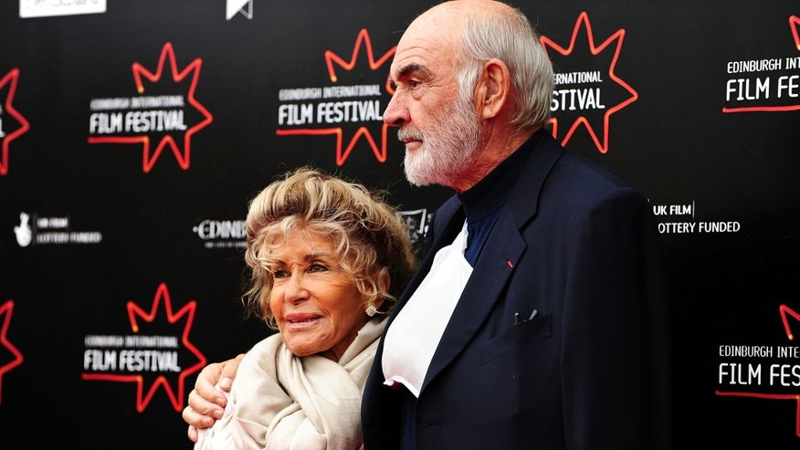 "EDINBURGH, UNITED KINGDOM - JUNE 21:  EIFF patron Sir Sean Connery and his wife Micheline attend the red carpet gala for the film ""Stone of Destiny"" on day four of the Edinburgh International Film Festival at Cineworld on June 21, 2008 in Edinburgh, Scotland  (Photo by Martin McNeil/Getty Images)"