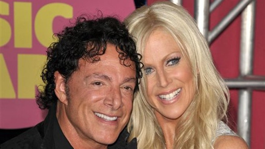 June 6, 2012: In this file photo, Neal Schon, left, and Michaele Salahi arrive at the CMT Music Awards in Nashville, Tenn.