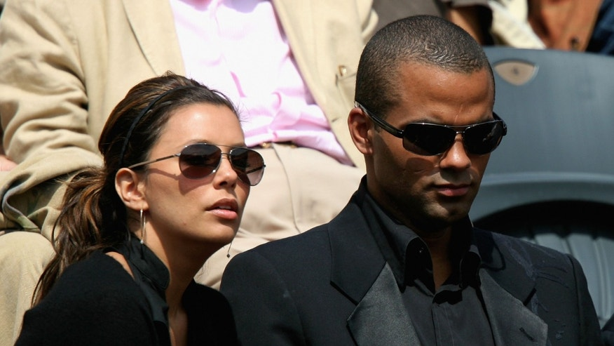 PARIS - JUNE 05:  Actress Eva Longoria and her husband, NBA Basketball player Tony Parker watch the action during the Men's Singles Semi Final match between Robin Soderling of Sweden and Fernando Gonzalez of Chile on day thirteen of the French Open at Roland Garros on June 5, 2009 in Paris, France.  (Photo by Matthew Stockman/Getty Images)