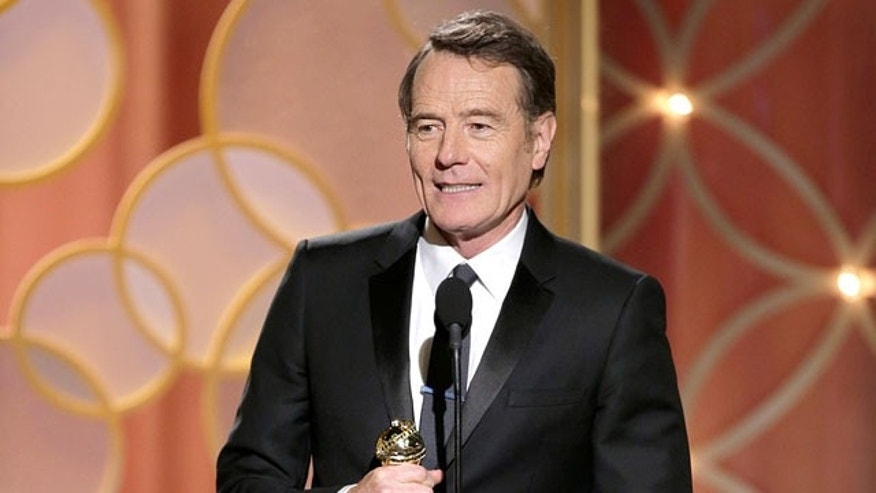 Bryan Cranston accepts an award.