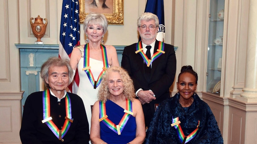 Dec 5, 2015. The 2015 Kennedy Center Honorees, from left, Seiji Ozawa, Rita Moreno, Carole King, George Lucas and Cicely Tyson pose for a group photo following the State Department Dinner for the Kennedy Center Honors in Washington.