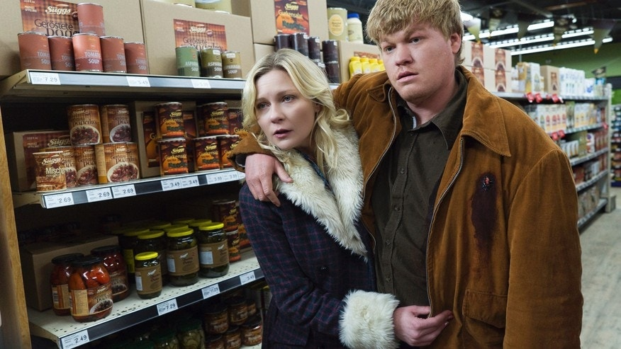"In this image released by FX, Kirsten Dunst, left, and Jesse Plemons appear in a scene from ""Fargo."""