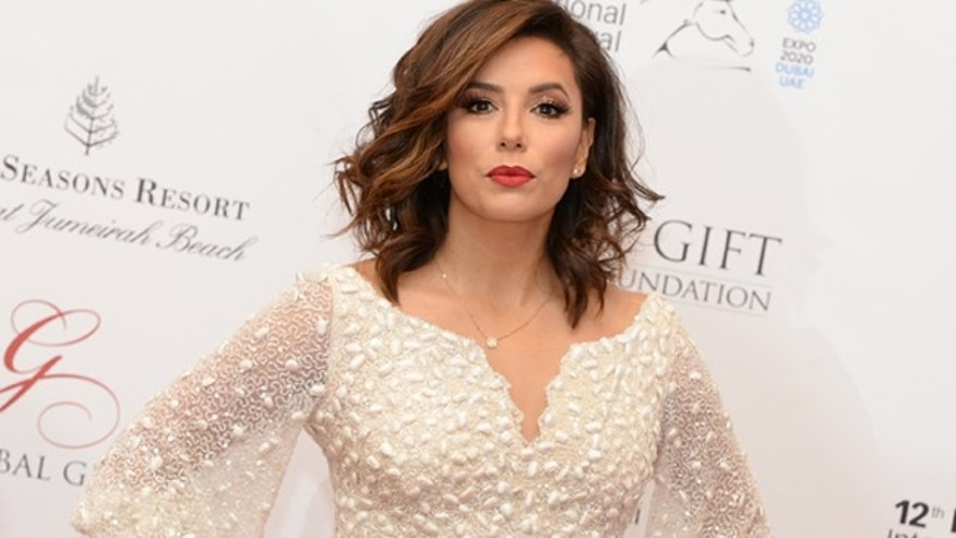 American actress Eva Longoria poses on the red carpet at the Global Gift Foundation Gala.