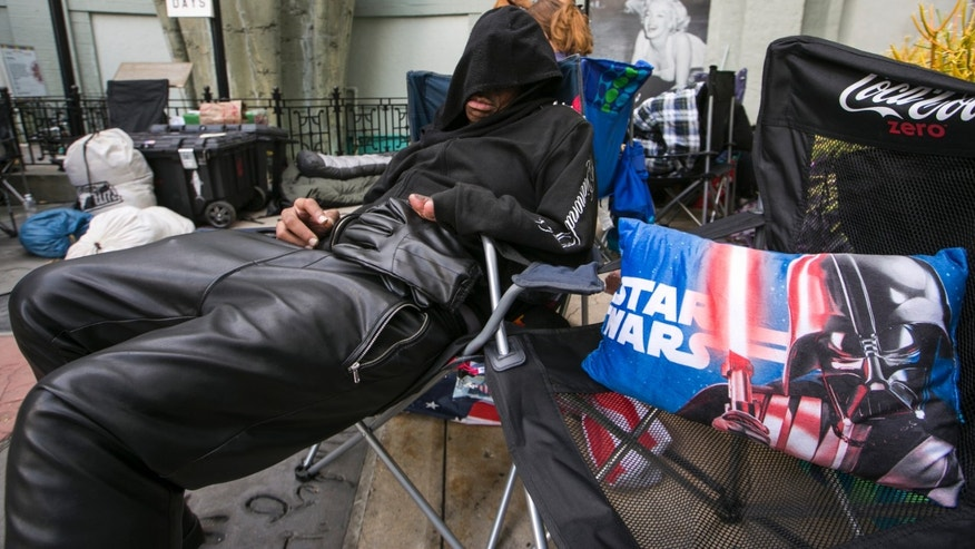 """Dec. 9, 2015 . """"Star Wars"""" fan, actor Deuce Wayne, from Virginia, rests outside the TCL Chinese Theater Imax while waiting for the premiere of """"Star Wars: The Force Awakens"""" in Los Angeles."""