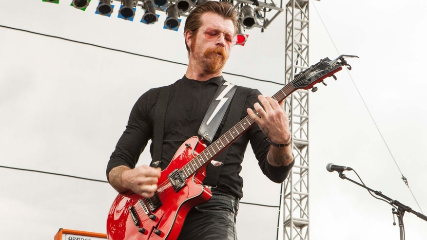 FILE - In this Sept. 11, 2015 file photo, Jesse Hughes of Eagles of Death Metal performs at Riot Fest & Carnival in Chicago.