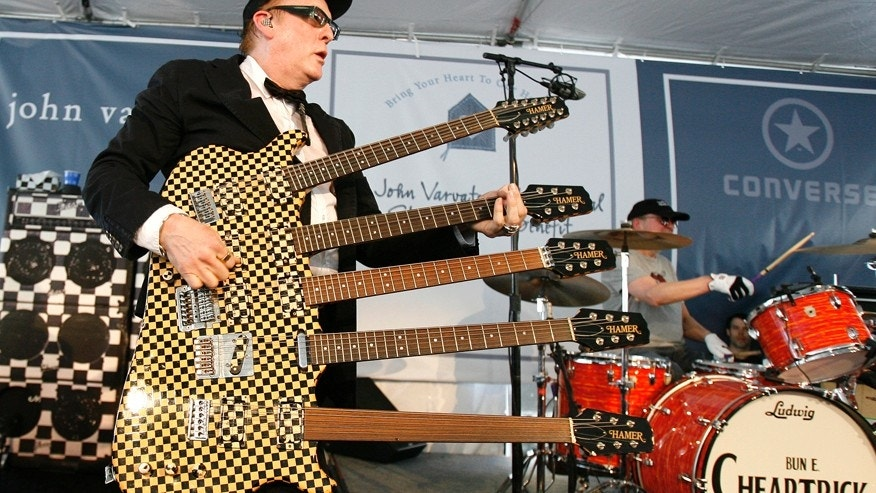 Lead guitarist Rick Nielsen performs with his band Cheap Trick at the 6th annual John Varvatos Stuart House Benefit in West Hollywood, California March 9, 2008. Stuart House is a program of the Rape Treatment Center at Santa Monica-UCLA Medical Center and serves the special needs of child victims of sexual abuse.   REUTERS/Mario Anzuoni   (UNITED STATES) - RTR1Y3ZB