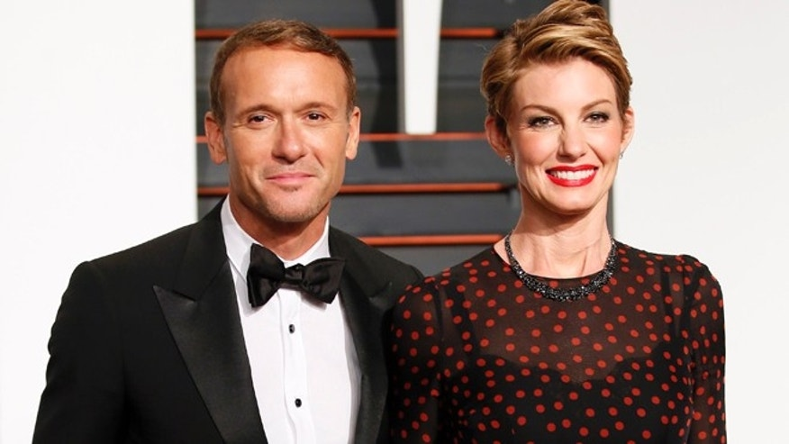 Feb 22, 2015. Country musicians Tim McGraw and wife, Faith Hill, arrive at the 2015 Vanity Fair Oscar Party in Beverly Hills, California.