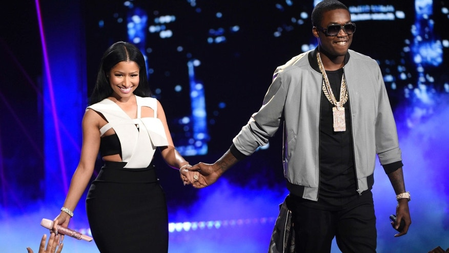 File- This June 28, 2015, file photo shows Nicki Minaj, left, and Meek Mill at the BET Awards at the Microsoft Theater in Los Angeles.