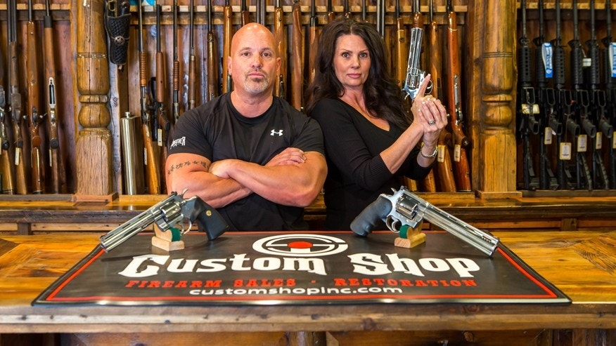 "Lou Tuminaro and his wife Theresa of ""The Gunfather"" pose in their Hamilton, Montana store The Custom Shop."