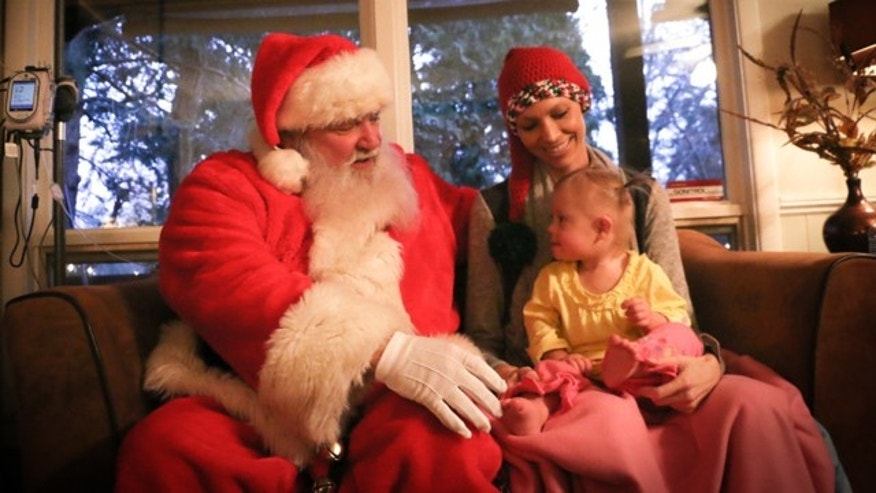 Joey Feek and daughter Indiana with Santa Claus.