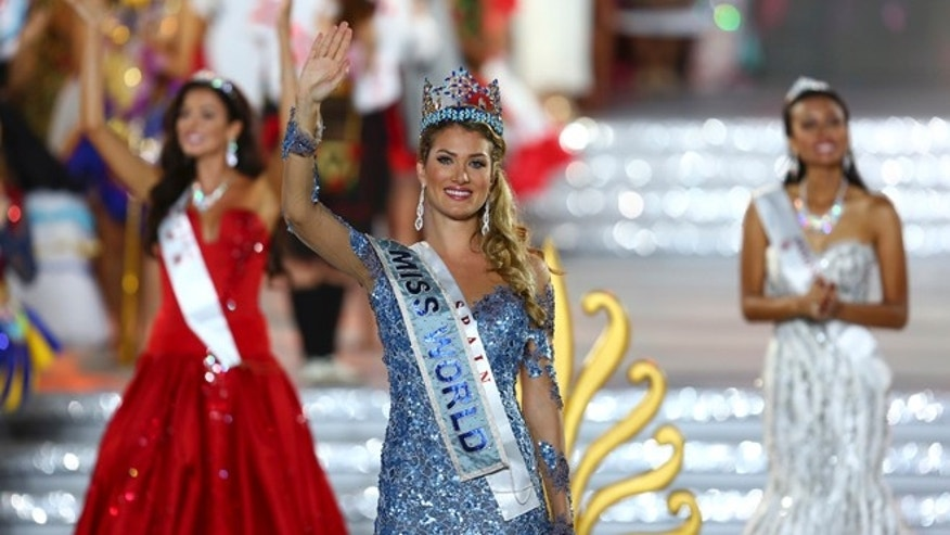 Newly crowned Miss World Mireia Lalaguna Royo from Spain celebrates after at the end of the 2015 Miss World Grand Final in Sanya in south China's Hainan province Saturday Dec. 19, 2015. Spain's Mireia Lalaguna Royo was named the winner of the Miss World 2015 competition Saturday night in the southern Chinese island resort of Sanya, an event dogged by controversy over China's refusal to allow Canada's entrant to attend. (Chinatopix Via AP) CHINA OUT