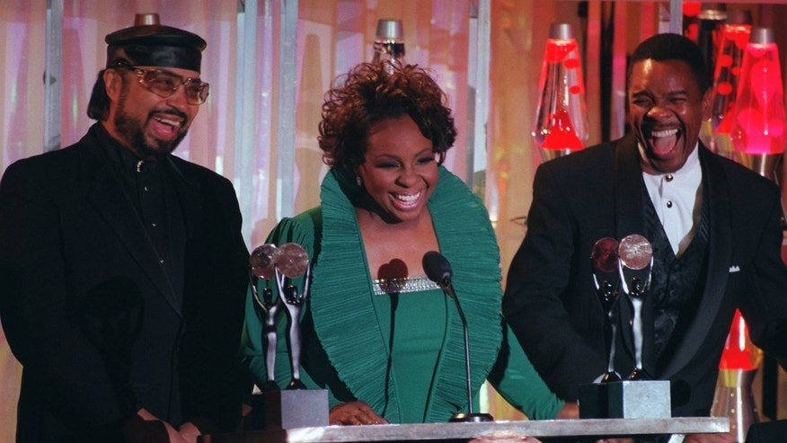 Jan. 17, 1996. Gladys Knight, center, William Guest, left, and Merald Knight take the stage as they are inducted into the Rock and Roll Hall of Fame during ceremonies in New York.