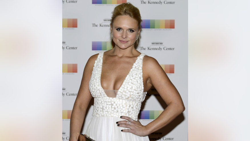 December 5, 2015. Country singer Miranda Lambert poses for photographers as she arrives for the Kennedy Center Honors gala dinner at the U.S. State Department in Washington, DC.