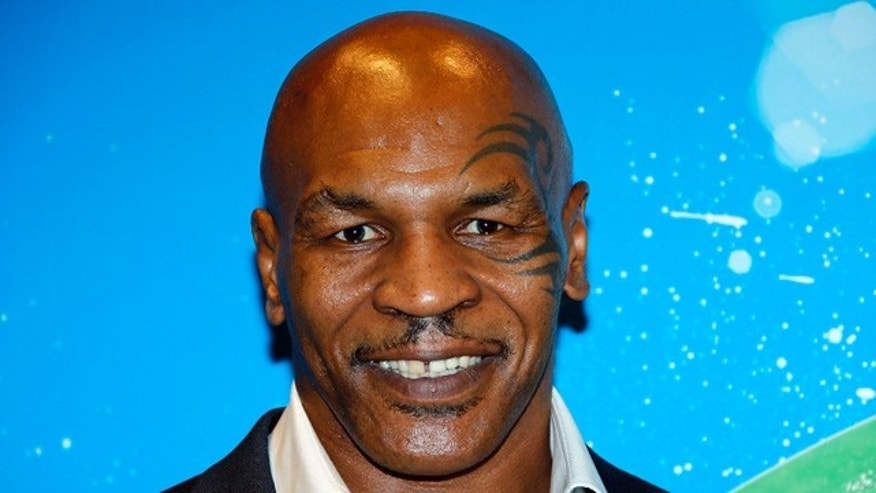 "October 8, 2014. Former professional boxer Mike Tyson poses before receiving the Sportel Special Prize Autobiography for his book ""Undisputed Truth: My Autobiography"" during the Golden Podium Awards at the Sportel in Monte Carlo."