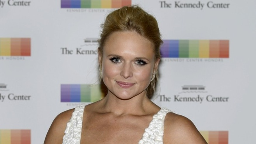 December 5, 2015. Country singer Miranda Lambert poses for photographers as she arrives for the Kennedy Center Honors gala dinner at the U.S. State Department in Washington.