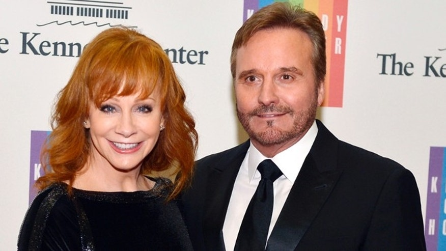 December 6, 2014. Country singer Reba McEntire and her husband Narvel Blackstock pose on the red carpet as they arrive ahead of the 37th Annual Kennedy Center gala dinner at the U.S. State Department, in Washington.