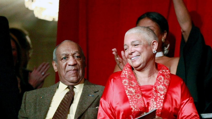 Oct. 26, 2009. Bill Cosby, left, and his wife Camille appear at the John F. Kennedy Center for Performing Arts before Bill Cosby received the Mark Twain Prize for American Humor in Washington.