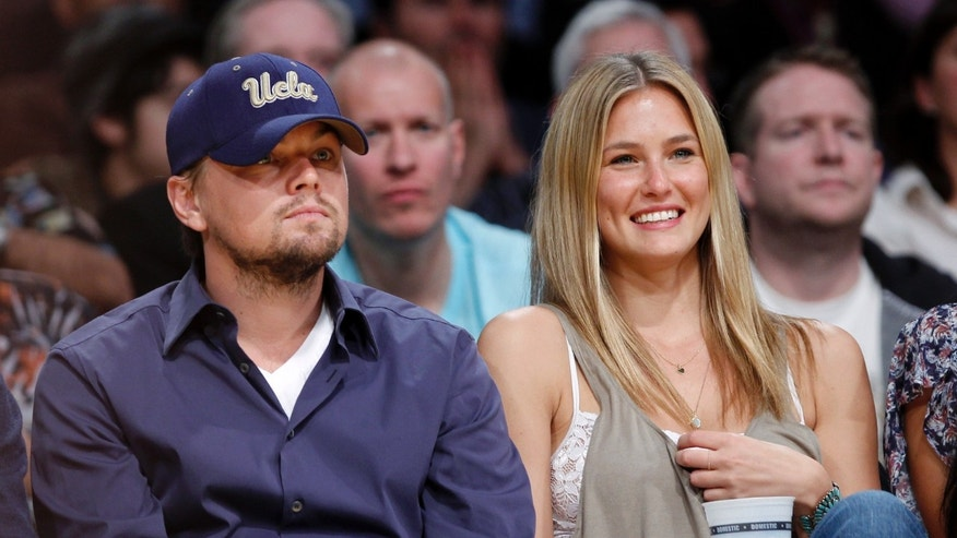 Actor Leonardo DiCaprio sits court side with his girlfriend, Israeli model Bar Refaeli as the Los Angeles Lakers play the Oklahoma Thunder during Game 5 of their NBA Western Conference playoff series in Los Angeles, April 27, 2010.   REUTERS/Lucy Nicholson (UNITED STATES - Tags: SPORT BASKETBALL ENTERTAINMENT PROFILE) - RTR2D7BU