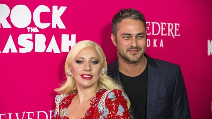 "October 19, 2015. Singer Lady Gaga arrives with Taylor Kinney for the premiere of the film ""Rock the Kasbah"" in New York."