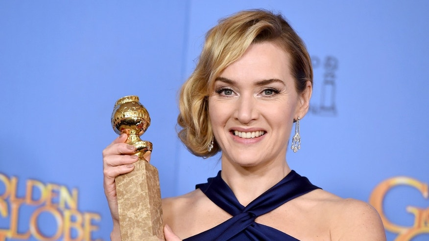 Kate Winslet poses in the press room with the award for best performance by an actress in a supporting role in a motion picture for Steve Jobs at the 73rd annual Golden Globe Awards on Sunday, Jan. 10, 2016, at the Beverly Hilton Hotel in Beverly Hills, Calif. (Photo by Jordan Strauss/Invision/AP)