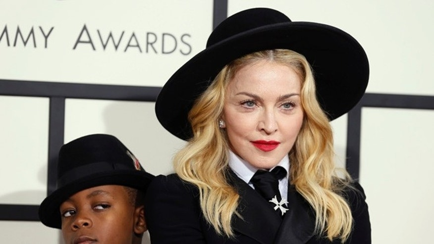 January 26, 2014. Madonna and her son, David Ritchie, arrive at the 56th annual Grammy Awards in Los Angeles, California.