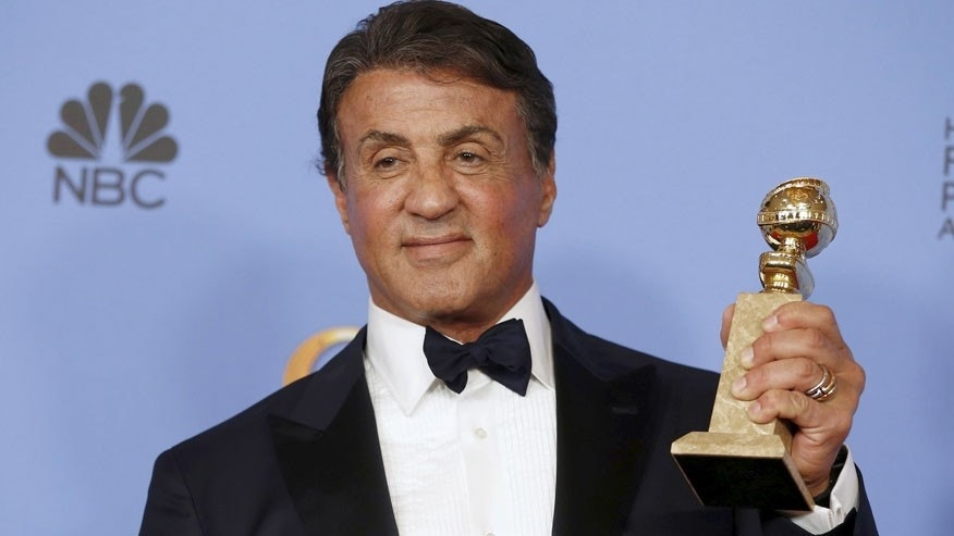 "Sylvester Stallone poses backstage with the award for Best Performance by an Actor in a Supporting Role in any Motion Picture for his role in ""Creed"" at the 73rd Golden Globe Awards in Beverly Hills, California, January 10, 2016.  REUTERS/Lucy Nicholson      TPX IMAGES OF THE DAY      - RTX21S9Z"