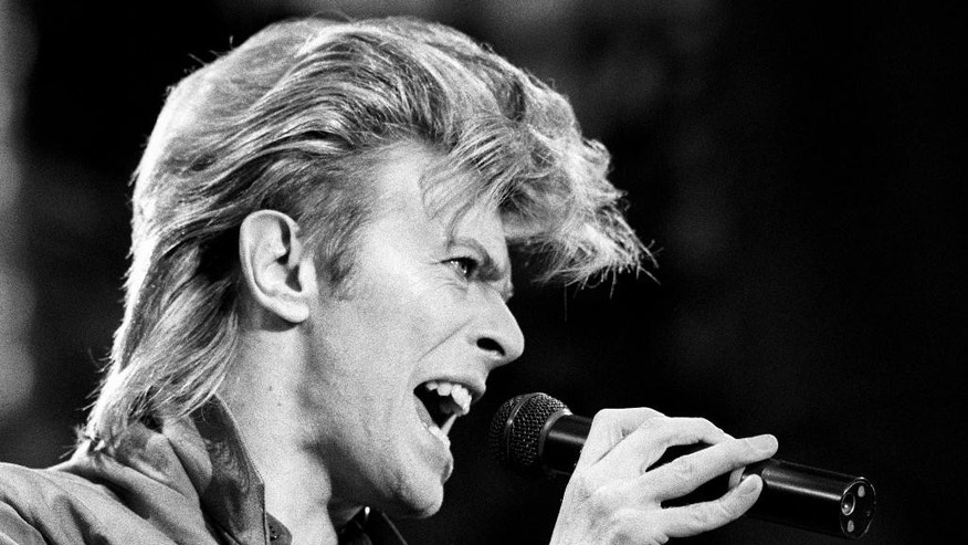 FILE - This is a June 19, 1987 file photo of David Bowie. Bowie, the other-worldly musician who broke pop and rock boundaries with his creative musicianship, nonconformity, striking visuals and a genre-bending persona he christened Ziggy Stardust, died of cancer Sunday Jan. 10, 2016. He was 69 and had just released a new album. (PA, File via AP) UNITED KINGDOM OUT