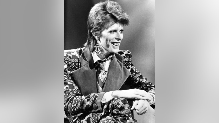 FILE - This is a Jan. 1, 1974  file photo of David Bowie. Bowie, the other-worldly musician who broke pop and rock boundaries with his creative musicianship, nonconformity, striking visuals and a genre-bending persona he christened Ziggy Stardust, died of cancer Sunday Jan. 10, 2016. He was 69 and had just released a new album. (PA, File via AP) UNITED KINGDOM OUT