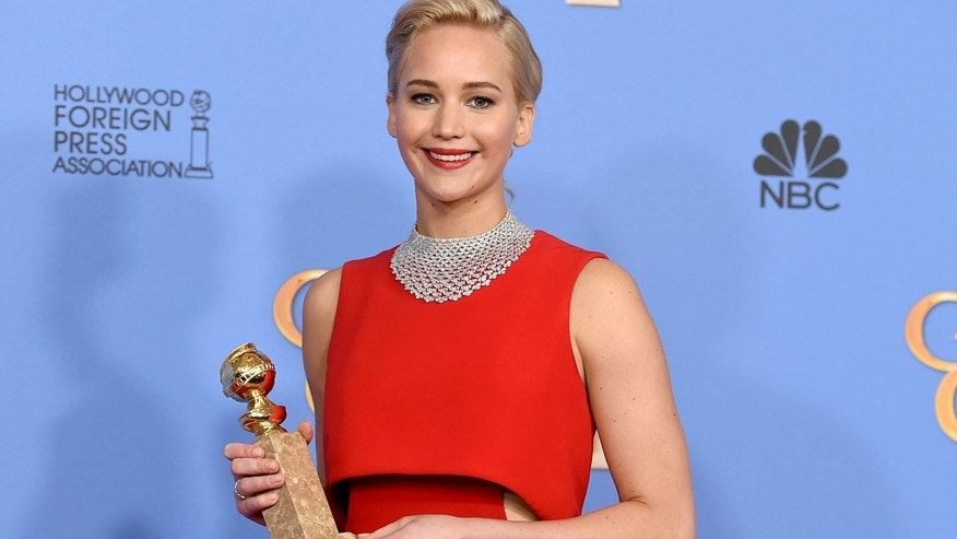 Jennifer Lawrence poses in the press room with the award for best performance by an actress in a motion picture - musical or comedy for Joy at the 73rd annual Golden Globe Awards on Sunday, Jan. 10, 2016, at the Beverly Hilton Hotel in Beverly Hills, Calif.