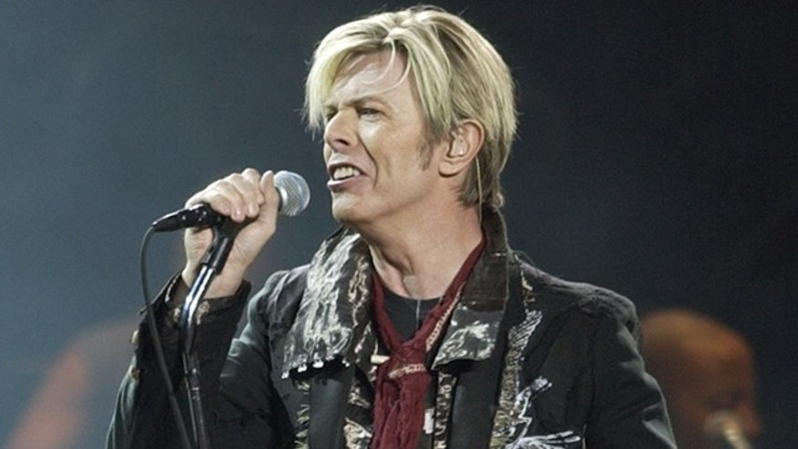 FILE - In this Dec. 15, 2003 file photo, singer/songwriter David Bowie launches his United States leg of his worldwide tour called 'A Reality Tour' at Madison Square Garden in New York. Bowie, the innovative and iconic singer whose illustrious career lasted five decades, died Monday, Jan. 11, 2016, after battling cancer for 18 months. He was 69 (AP Photo/Kathy Willens, File)