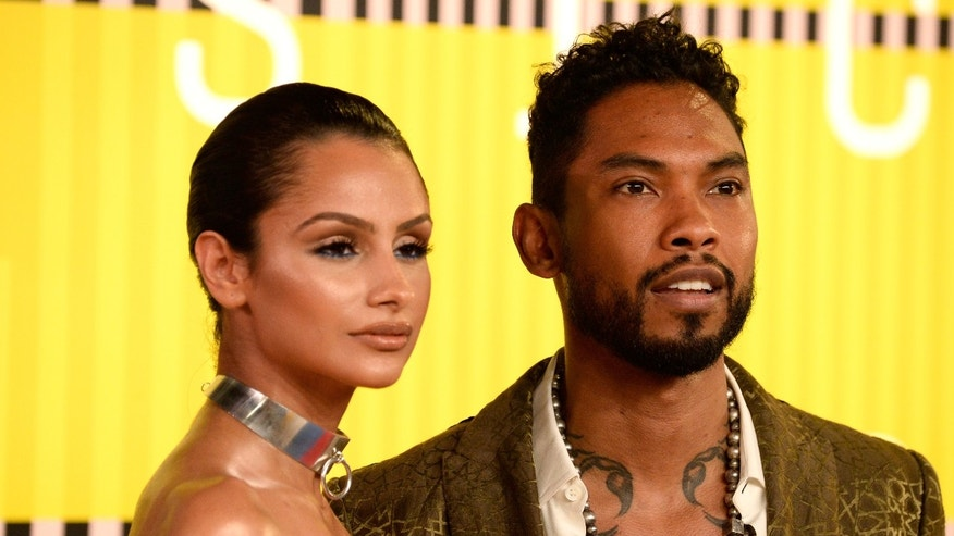 Actress Nazanin Mandi and Miguel attend the 2015 MTV Video Music Awards on August 30, 2015 in Los Angeles.