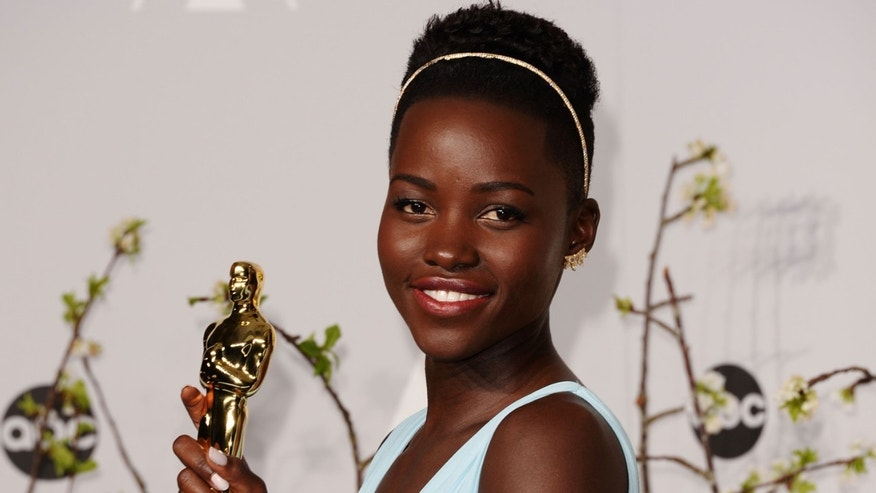 HOLLYWOOD, CA - MARCH 02:  Actress Lupita Nyong'o poses  in the press room during the Oscars at Loews Hollywood Hotel on March 2, 2014 in Hollywood, California.  (Photo by Jason Merritt/Getty Images)