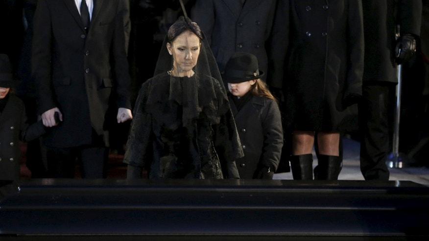 January 22, 2016. Singer Celine Dion walks up to the casket of her husband Rene Angelil following his funeral at Notre Dame Basilica in Montreal.